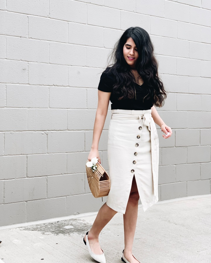 Black top with beige skirt